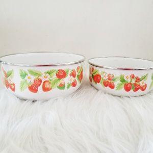 Two vintage strawberry enamel bowls